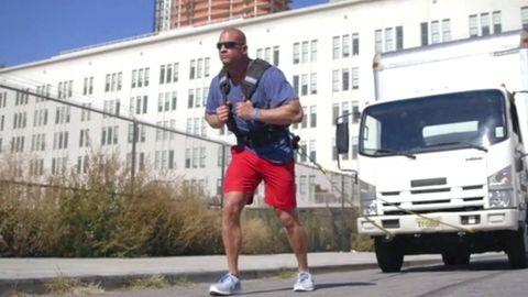 Window, Human leg, Neighbourhood, Asphalt, Truck, Active shorts, Shorts, Elbow, Commercial vehicle, Grille,
