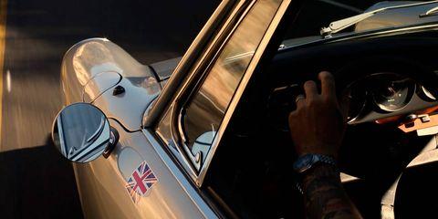 Motor vehicle, Automotive design, Vehicle door, Personal luxury car, Luxury vehicle, Steering wheel, Performance car, Windshield, Automotive mirror, Automotive window part,