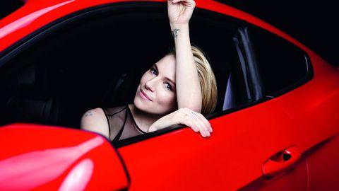 Automotive design, Automotive exterior, Red, Vehicle door, Hood, Flash photography, Car seat, Model, Brown hair, Luxury vehicle,