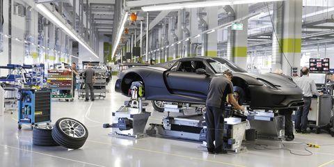 Automotive design, Automotive tire, Automotive wheel system, Floor, Engineering, Machine, Factory, Auto part, Service, Automobile repair shop,