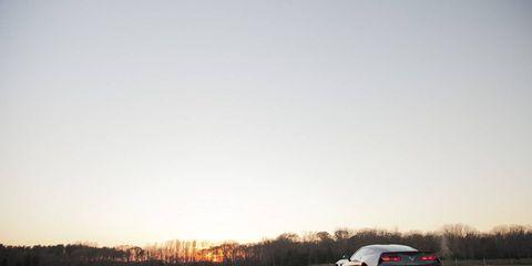 Automotive design, Vehicle, Land vehicle, Automotive tail & brake light, Automotive lighting, Car, Alloy wheel, Rim, Automotive parking light, Horizon,