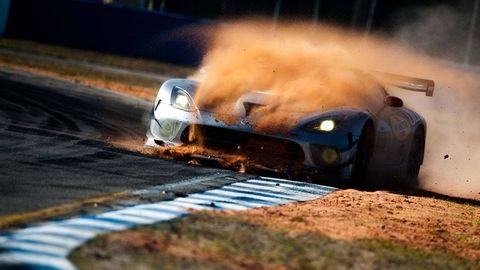 Automotive design, Hood, Automotive exterior, Motorsport, Auto part, Dust, Synthetic rubber, Bumper, Automotive wheel system, Racing,