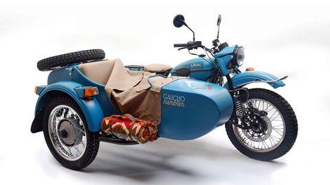 Tire, Wheel, Motor vehicle, Automotive design, Blue, Automotive tire, Transport, Vehicle, Motorcycle, Rim,