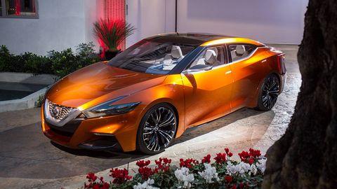 Mode of transport, Automotive design, Vehicle, Car, Automotive lighting, Alloy wheel, Rim, Orange, Mid-size car, Personal luxury car,