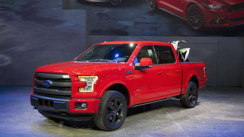 Tire, Wheel, Motor vehicle, Automotive design, Vehicle, Automotive tire, Land vehicle, Rim, Red, Automotive lighting,