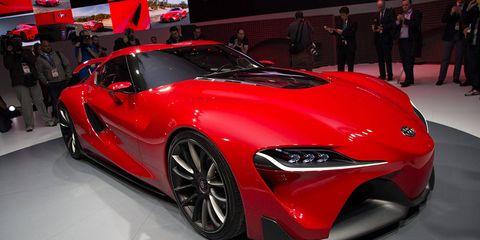 Wheel, Tire, Automotive design, Vehicle, Event, Land vehicle, Car, Red, Auto show, Exhibition,