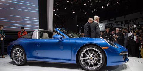 Tire, Wheel, Automotive design, Vehicle, Land vehicle, Alloy wheel, Performance car, Car, Spoke, Rim,