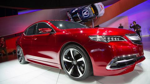 Tire, Wheel, Automotive design, Product, Vehicle, Event, Car, Red, Auto show, Automotive lighting,
