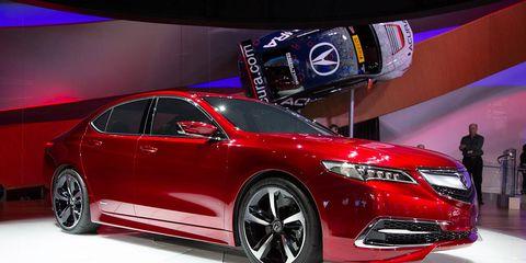 Tire, Wheel, Automotive design, Vehicle, Event, Land vehicle, Car, Auto show, Exhibition, Automotive lighting,
