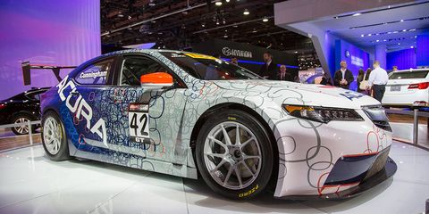 Tire, Wheel, Automotive design, Vehicle, Land vehicle, Event, Car, Auto show, Rim, Automotive tire,