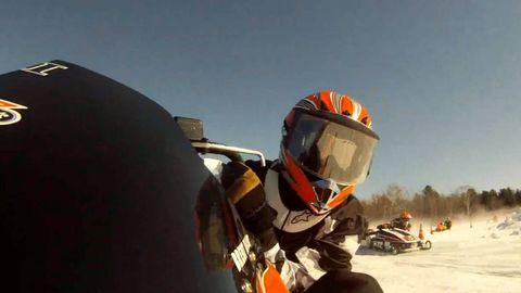 Helmet, Personal protective equipment, Motorcycle helmet, Winter, Sports gear, Snow, Geological phenomenon, Racing, Freezing, Auto racing,