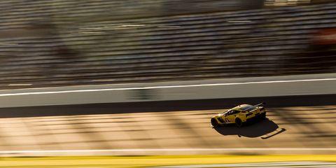 Automotive design, Yellow, Race track, Automotive exterior, Automotive tire, Automotive lighting, Motorsport, Auto part, Sports car racing, Touring car racing,
