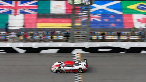 Automotive design, Race track, Colorfulness, Motorsport, Race car, Asphalt, Automotive tire, Racing, Auto racing, Auto part,