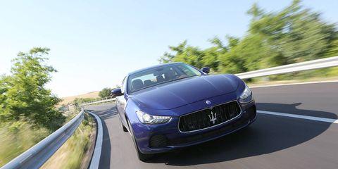 Motor vehicle, Road, Mode of transport, Automotive design, Transport, Grille, Infrastructure, Automotive mirror, Road surface, Car,