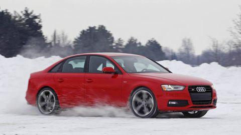 Tire, Wheel, Automotive design, Vehicle, Automotive mirror, Land vehicle, Winter, Automotive tire, Car, Red,