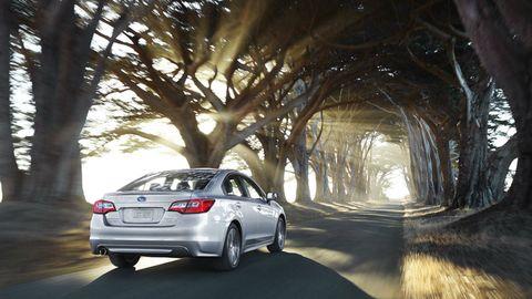Automotive tail & brake light, Automotive design, Vehicle, Automotive lighting, Land vehicle, Car, Rim, Alloy wheel, Automotive exterior, Mid-size car,