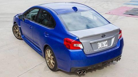 Tire, Wheel, Blue, Automotive design, Vehicle, Automotive tire, Rim, Alloy wheel, Car, Automotive lighting,
