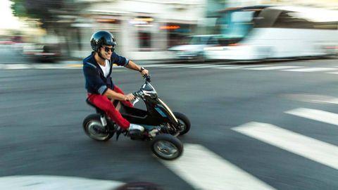 Mode of transport, Automotive design, Scooter, Helmet, Motorcycle helmet, Automotive tire, Fender, Automotive wheel system, Auto part, Street fashion,