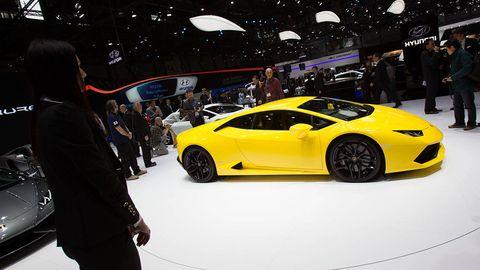 Tire, Wheel, Automotive design, Vehicle, Event, Yellow, Land vehicle, Performance car, Car, Supercar,
