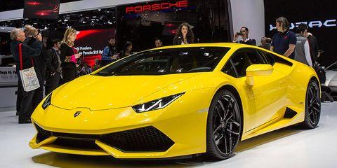 Automotive design, Yellow, Vehicle, Event, Land vehicle, Car, Supercar, Auto show, Exhibition, Sports car,