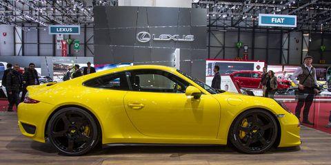 Tire, Wheel, Automotive design, Vehicle, Yellow, Land vehicle, Rim, Performance car, Car, Automotive wheel system,
