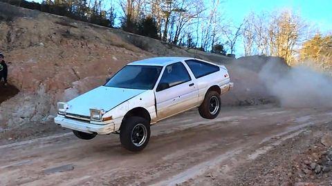 Tire, Wheel, Vehicle, Land vehicle, Car, Soil, Smoke, Dust, Dirt road, Hubcap,