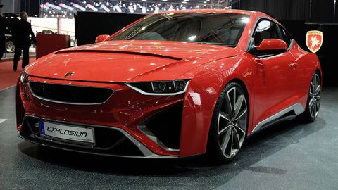 Automotive design, Vehicle, Event, Land vehicle, Car, Red, Personal luxury car, Alloy wheel, Performance car, Sports car,