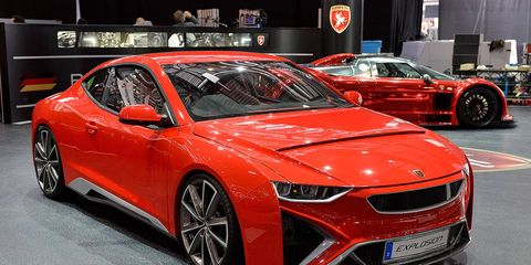 Wheel, Tire, Mode of transport, Automotive design, Vehicle, Land vehicle, Event, Car, Red, Personal luxury car,
