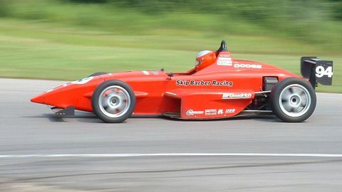 Tire, Wheel, Automotive tire, Automotive design, Vehicle, Automotive wheel system, Open-wheel car, Race track, Formula one, Red,