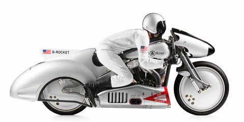 Motorcycle, Wheel, Automotive design, Vehicle, Land vehicle, Helmet, Automotive lighting, Automotive tire, Motorcycle helmet, Personal protective equipment,