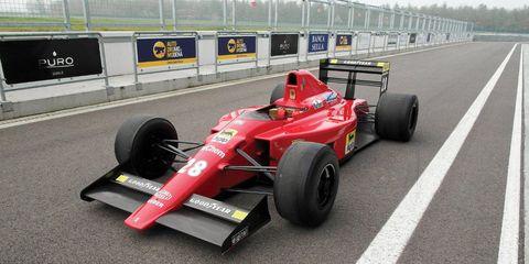 Tire, Wheel, Automotive tire, Automotive design, Open-wheel car, Formula one tyres, Vehicle, Formula one car, Automotive wheel system, Asphalt,