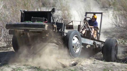 Tire, Wheel, Human, Automotive tire, Vehicle, Automotive wheel system, Auto part, Fender, Soil, Tread,