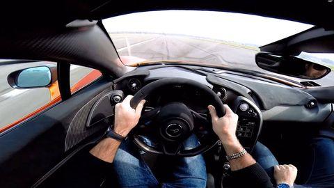 Steering part, Automotive mirror, Automotive design, Steering wheel, Car, Personal luxury car, Rear-view mirror, Luxury vehicle, Center console, Speedometer,