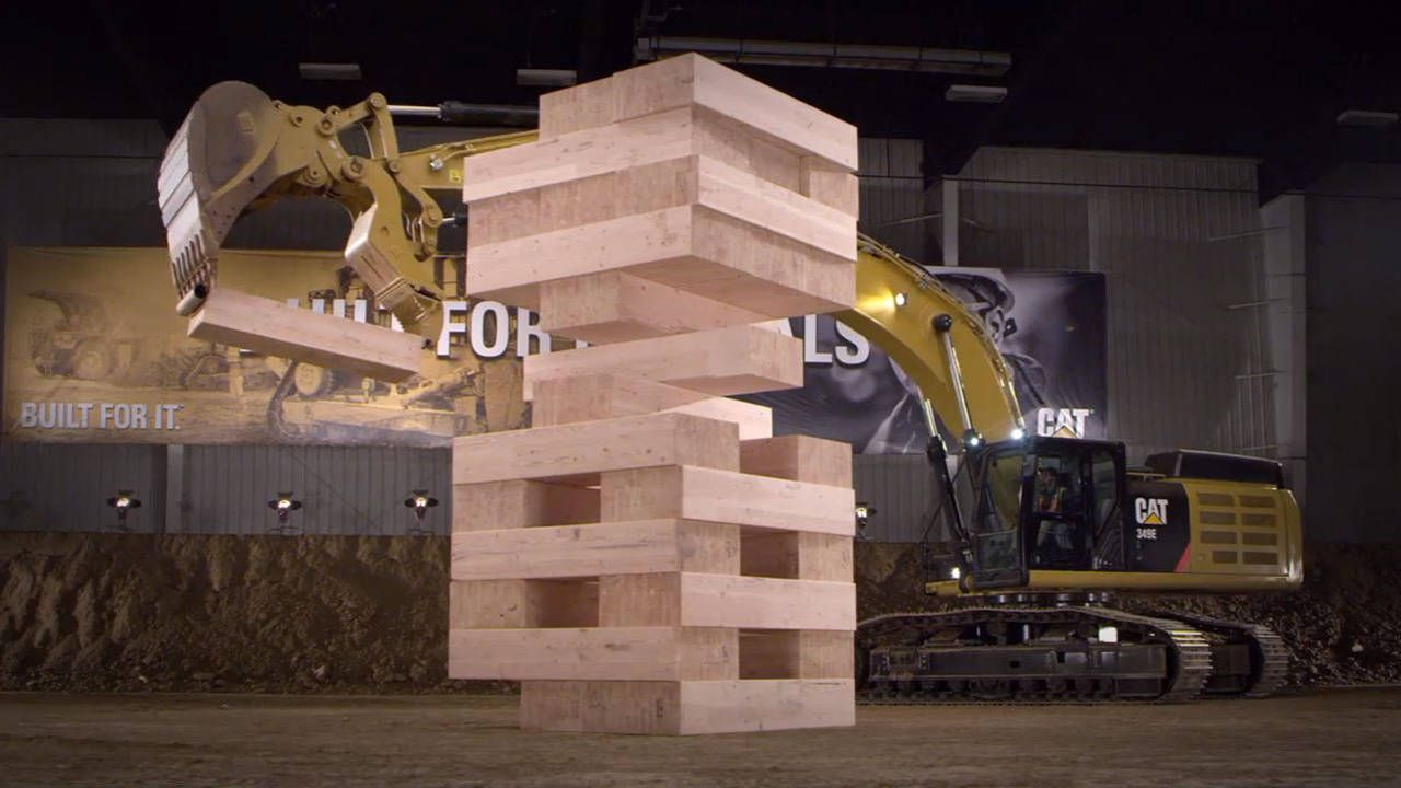 Watch these Caterpillar excavators play the biggest game of Jenga ever