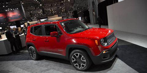 Tire, Motor vehicle, Wheel, Automotive design, Vehicle, Land vehicle, Automotive lighting, Automotive tire, Car, Red,