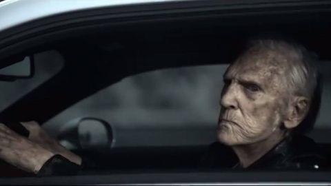 Automotive design, Forehead, Automotive mirror, Jaw, Vehicle door, Steering wheel, Wrinkle, Steering part, Luxury vehicle, Rear-view mirror,