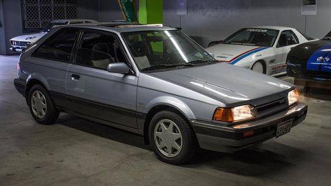 Land vehicle, Vehicle, Car, Automotive design, Sedan, Mazda familia, Compact car, Hatchback, Classic car, Coupé,