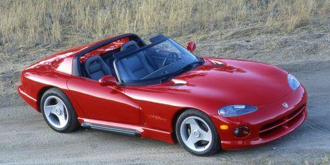 Tire, Automotive design, Vehicle, Red, Rim, Hood, Performance car, Car, Alloy wheel, Fender,