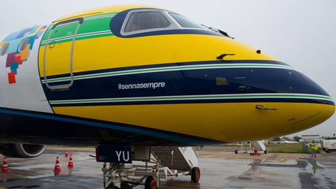 Mode of transport, Transport, Yellow, Aircraft, Airplane, Public transport, Glass, Automotive tire, Aerospace engineering, Air travel,