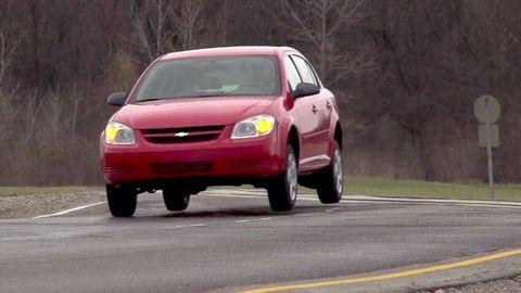 Motor vehicle, Road, Automotive design, Vehicle, Yellow, Land vehicle, Automotive mirror, Transport, Infrastructure, Automotive lighting,