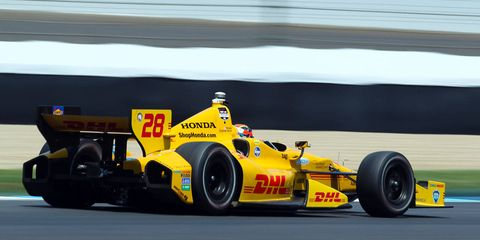 Tire, Wheel, Automotive tire, Mode of transport, Automotive design, Open-wheel car, Formula one tyres, Automotive wheel system, Yellow, Race track,