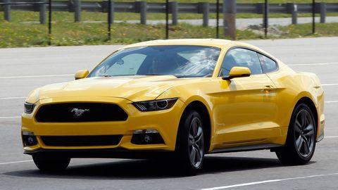 Tire, Motor vehicle, Automotive design, Daytime, Yellow, Vehicle, Hood, Headlamp, Infrastructure, Transport,