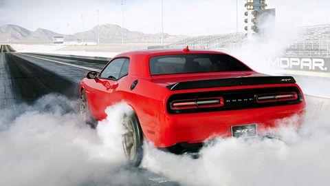 Motor vehicle, Automotive design, Automotive tire, Automotive exterior, Vehicle, Transport, Hood, Automotive lighting, Car, Red,