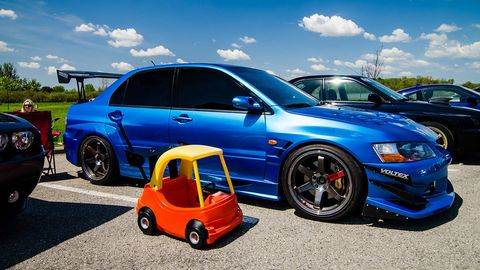Tire, Wheel, Automotive design, Blue, Vehicle, Land vehicle, Automotive wheel system, Alloy wheel, Rim, Car,