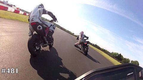 Motorcycle, Mode of transport, Motorcycle helmet, Automotive tire, Vehicle, Motorcycling, Automotive design, Helmet, Motorcycle racing, Race track,