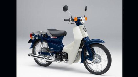 Tire, Motor vehicle, Wheel, Motorcycle, Automotive design, Blue, Transport, Vehicle, Automotive tire, Automotive lighting,
