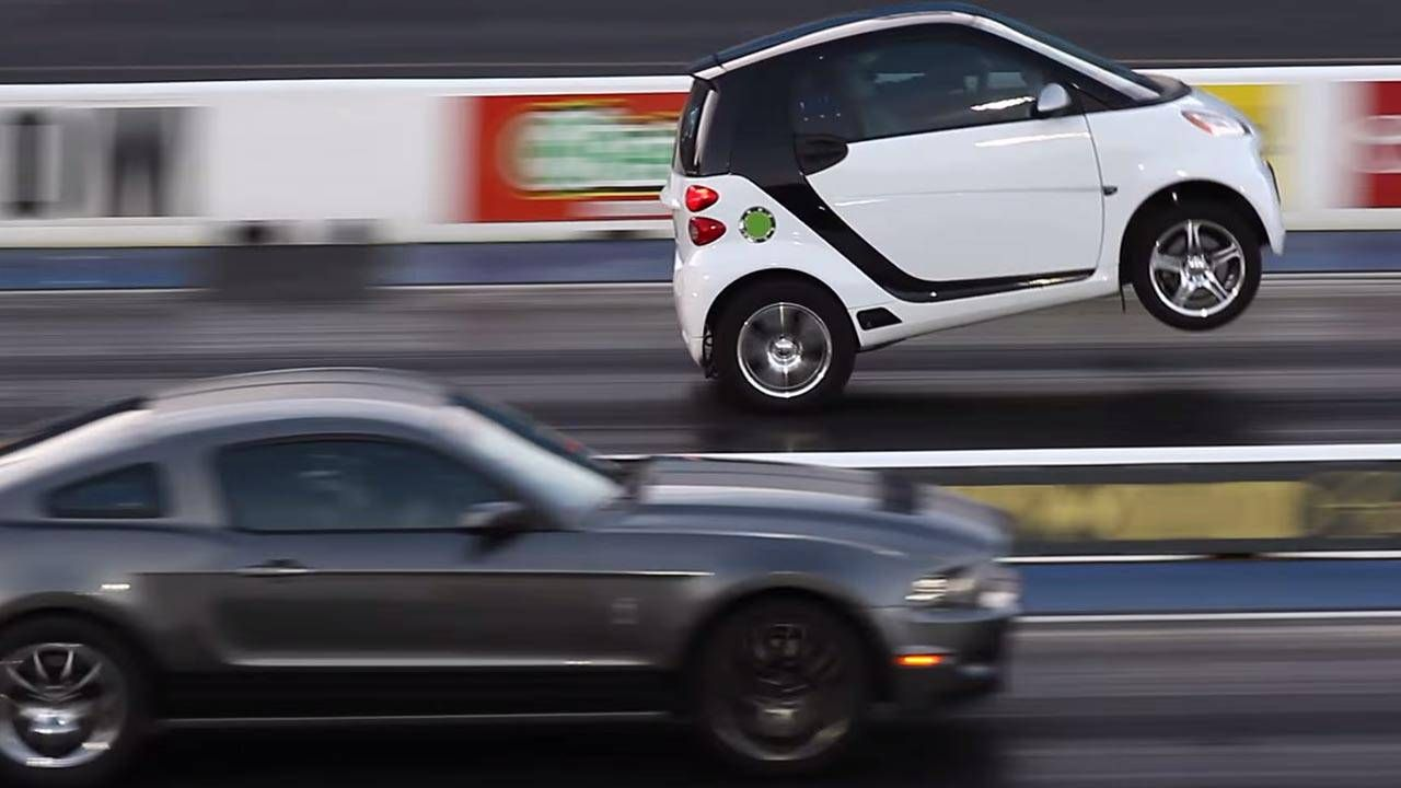 It's Smart vs. Mustang, and you won't guess which one wheelstands