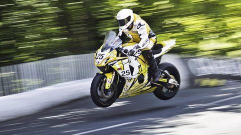 Motorcycle, Tire, Wheel, Motorcycling, Motorcycle helmet, Motorcycle racing, Automotive tire, Automotive design, Shoe, Motorsport,