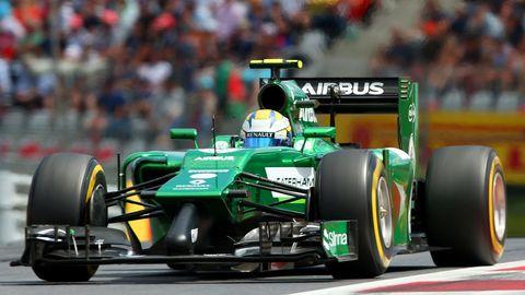 Tire, Wheel, Automotive tire, Automotive design, Mode of transport, Open-wheel car, Green, Vehicle, Automotive wheel system, Motorsport,