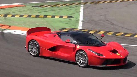 Tire, Mode of transport, Automotive design, Vehicle, Car, Performance car, Supercar, Red, Automotive mirror, Rim,